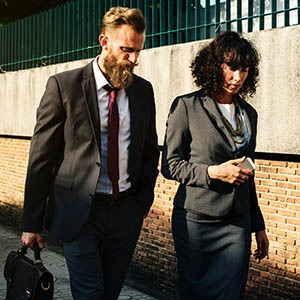 Business Man and Woman Walking Together