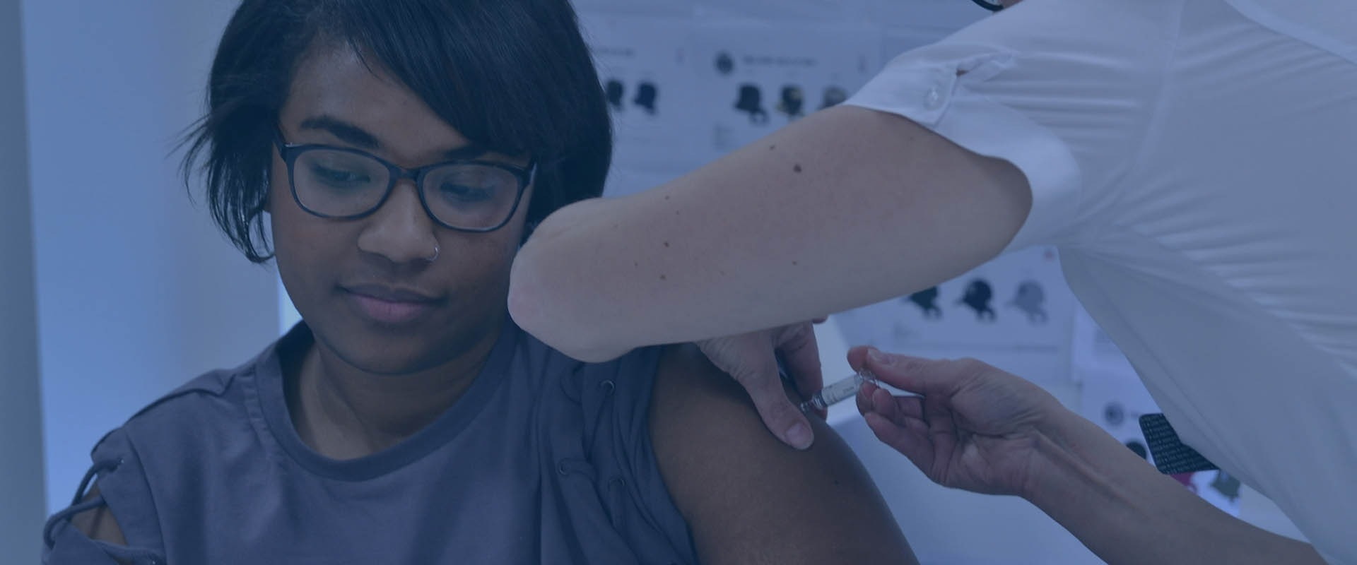 Employee receives flu vaccine at workplace flu clinic