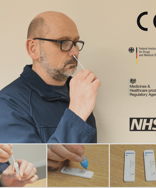 Man using COVID-19 lateral flow test kit